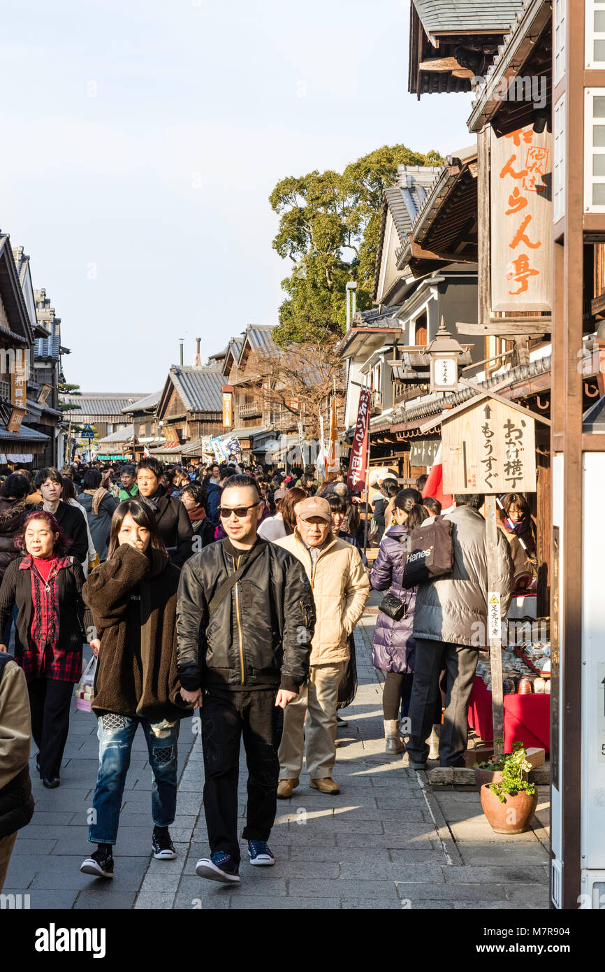Japan, Ise. Oharai-machi pedestrian street with Edo period restored stores and shops. People queuing at traditional - Stock Image