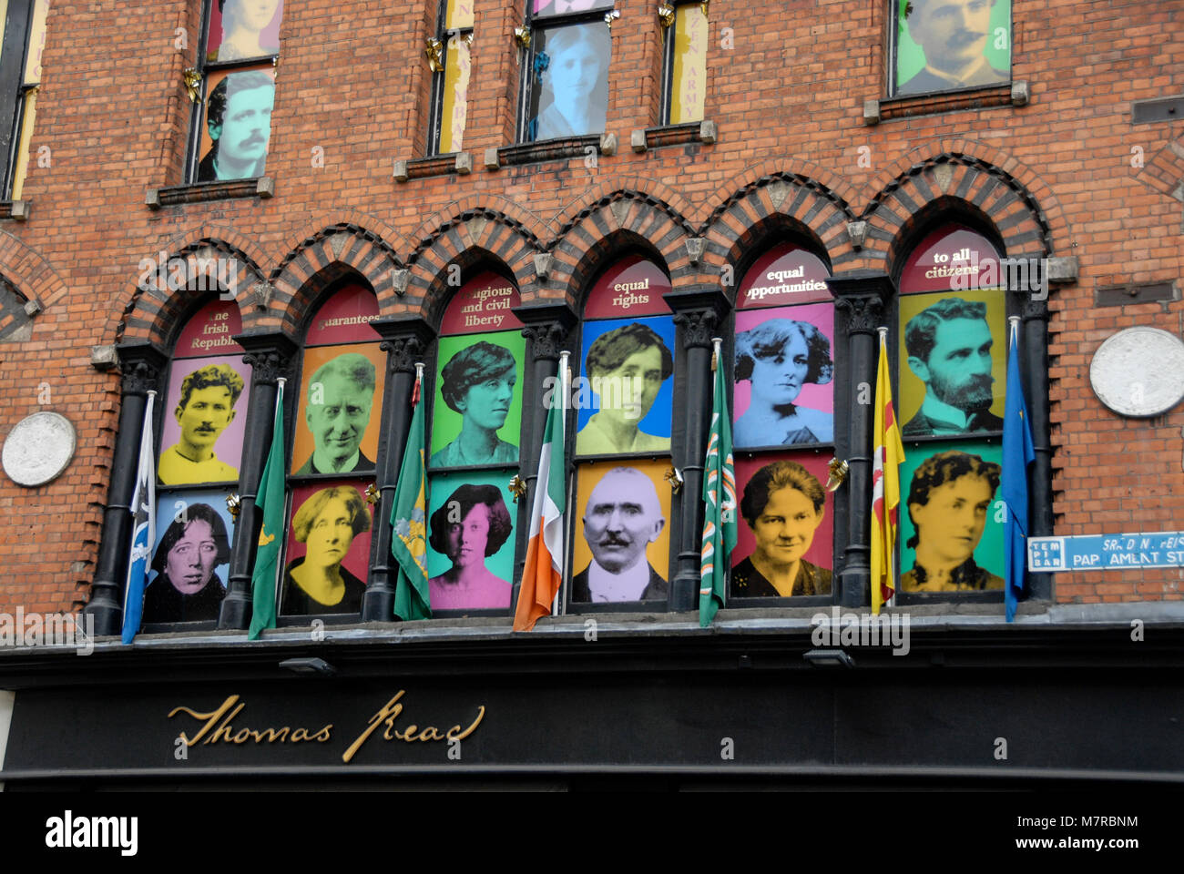 Portraits of members of the 1916 Irish Citizens Army in the windows of a building in Parliament Street, Dublin, - Stock Image