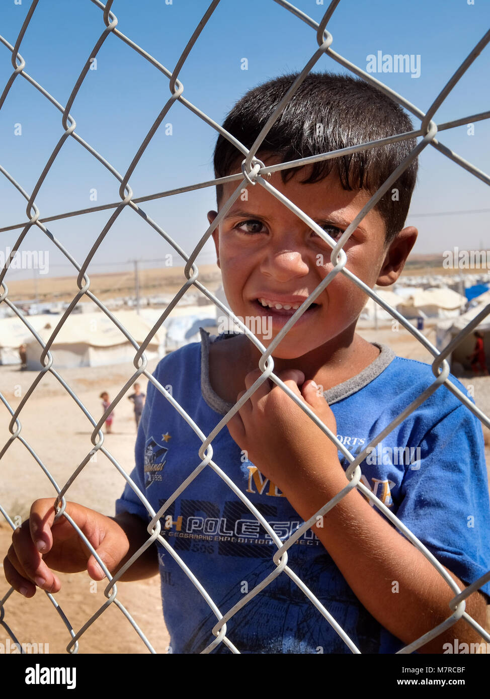 Kurdish child in Hasansham refugee camp for internally displaced persons (IDP) from Mosul near Erbil, northern Iraq, - Stock Image