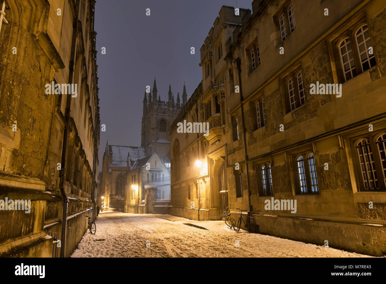 Corpus Christi college in Merton street in the snow early morning before dawn. Oxford, Oxfordshire, England - Stock Image