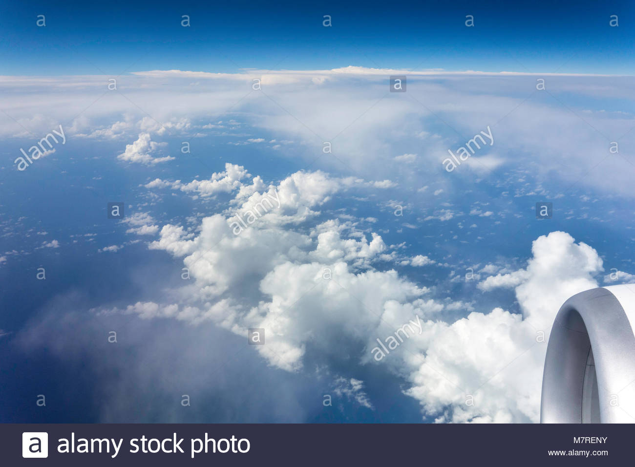 Warm moist air rising over mountainous Hawaiian islands create cumulonimbus clouds a hydrologic cycle in the state Stock Photo