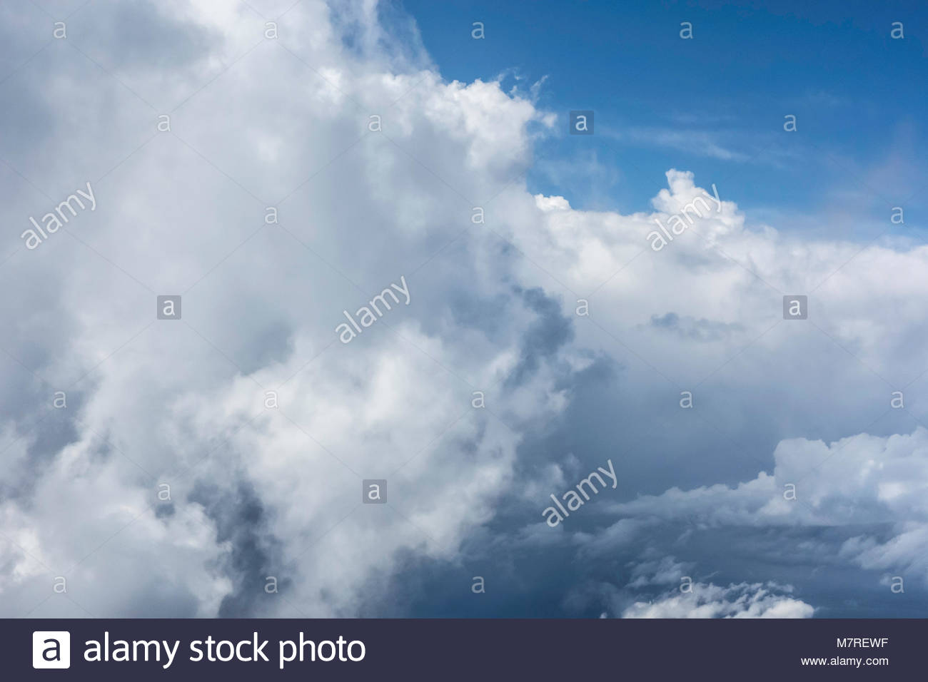 Warm moist air rising over mountainous Hawaiian islands create cumulonimbus clouds a hydrologic cycle in the state - Stock Image