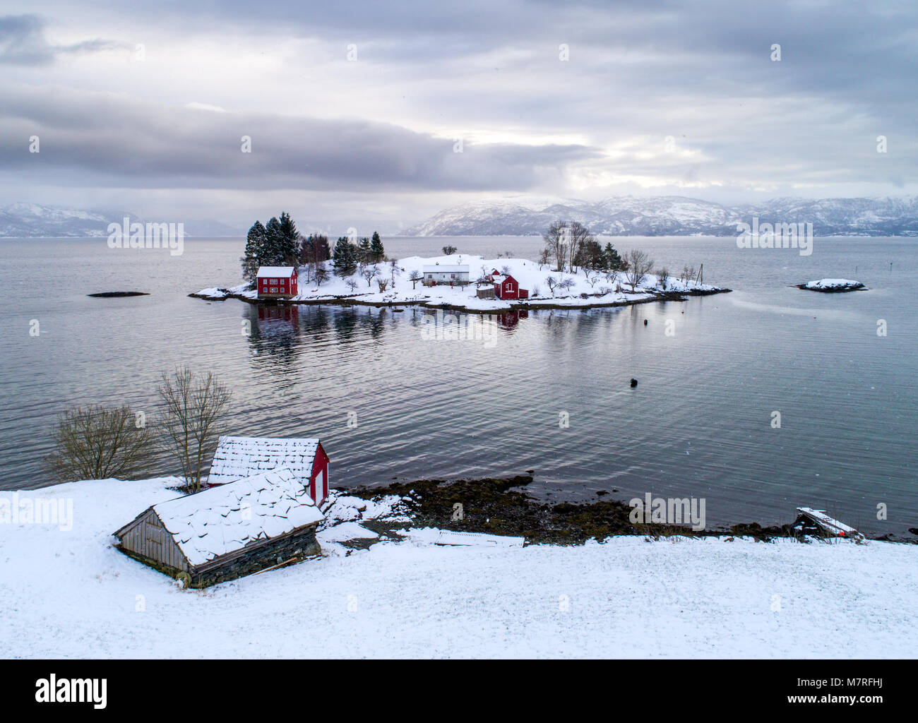 Winter on a small farm on a small island in the Norwegian fjord, Hardangerfjorden. - Stock Image