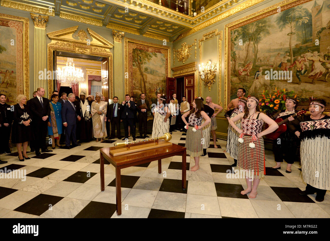 Guests enjoy a performance at a reception held at Marlborough House, the home of the Commonwealth Secretariat in Stock Photo