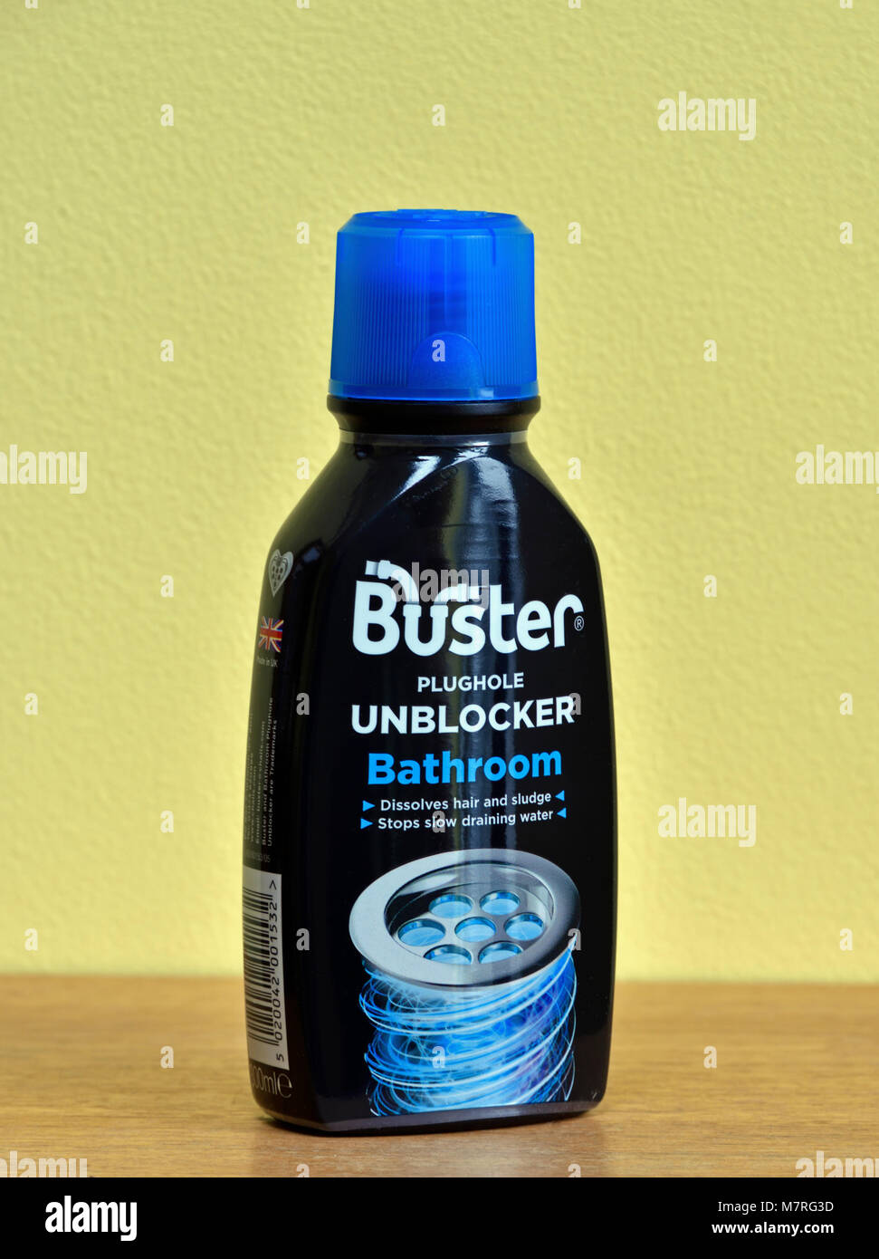 Plastic bottle of Buster Plughole Unblocker. Bathroom. Dissolves hair and sludge. Stops slow draining water. - Stock Image