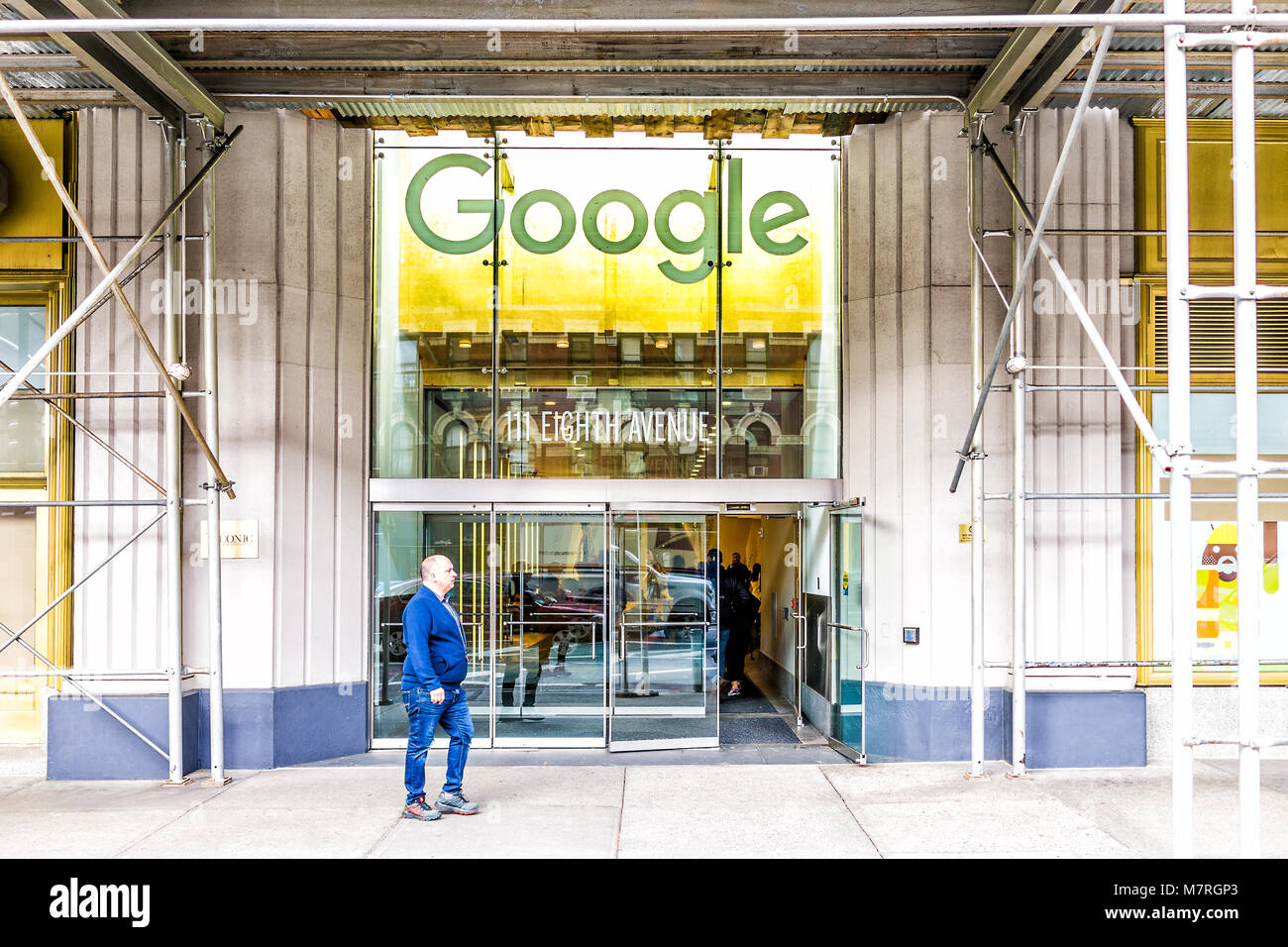 New York City, USA - October 30, 2017: Google Company Office Green Sign In  Downtown Lower Chelsea Neighborhood District Manhattan NYC, People Entering