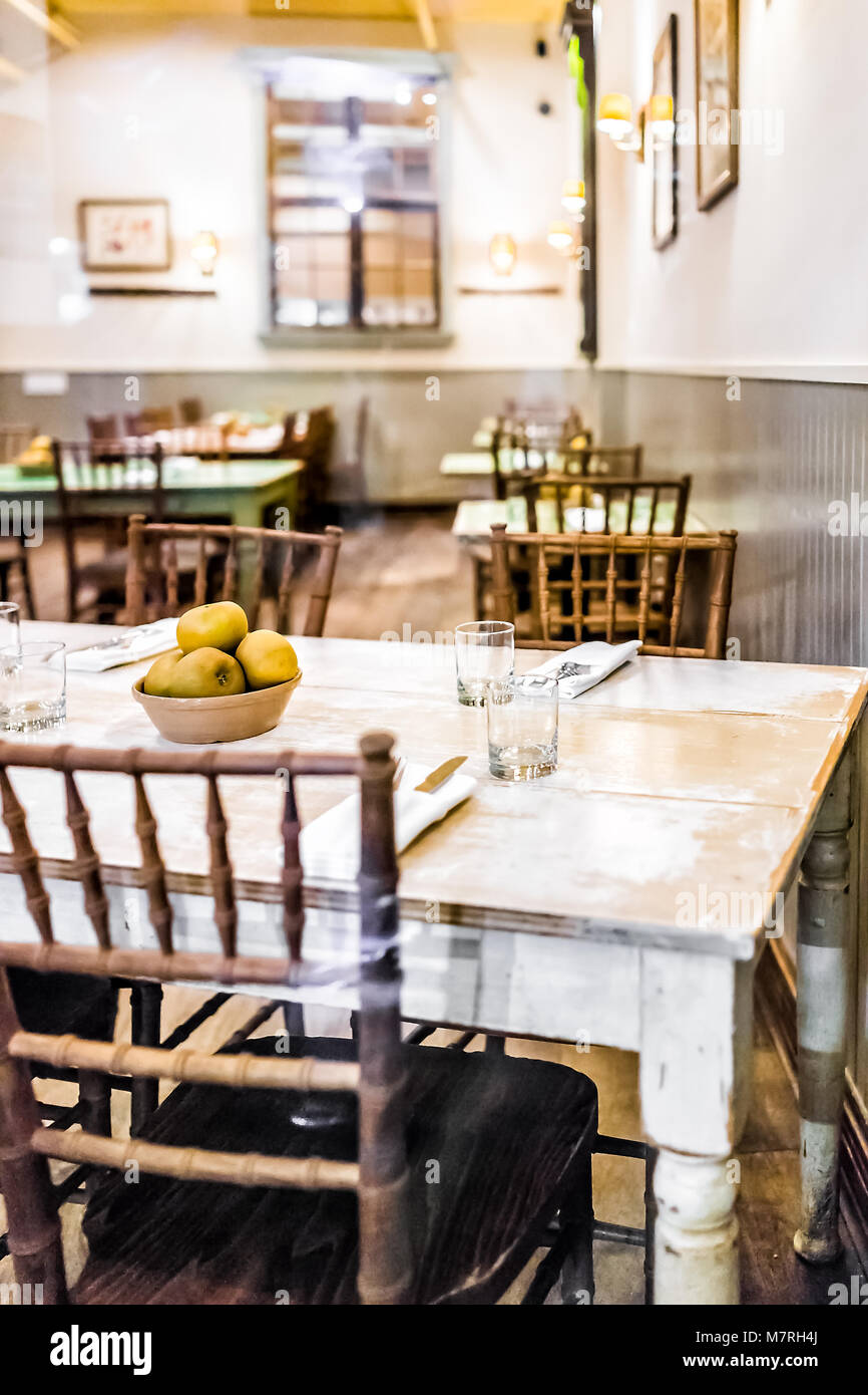 Many Restaurant Tables With Apple In Bowl Decorations Rustic Empty Plate Setting Chairs Glasses Forks Knives Cutlery Utensils Napkins