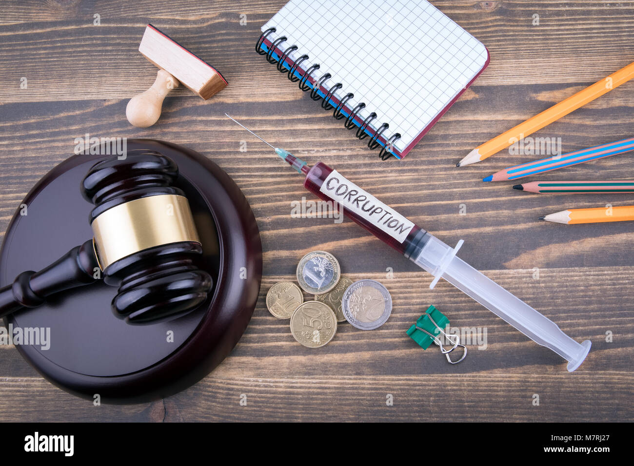 corruption concept. Medicine syringe with liquid inside and inscribtion. background to the business court's - Stock Image