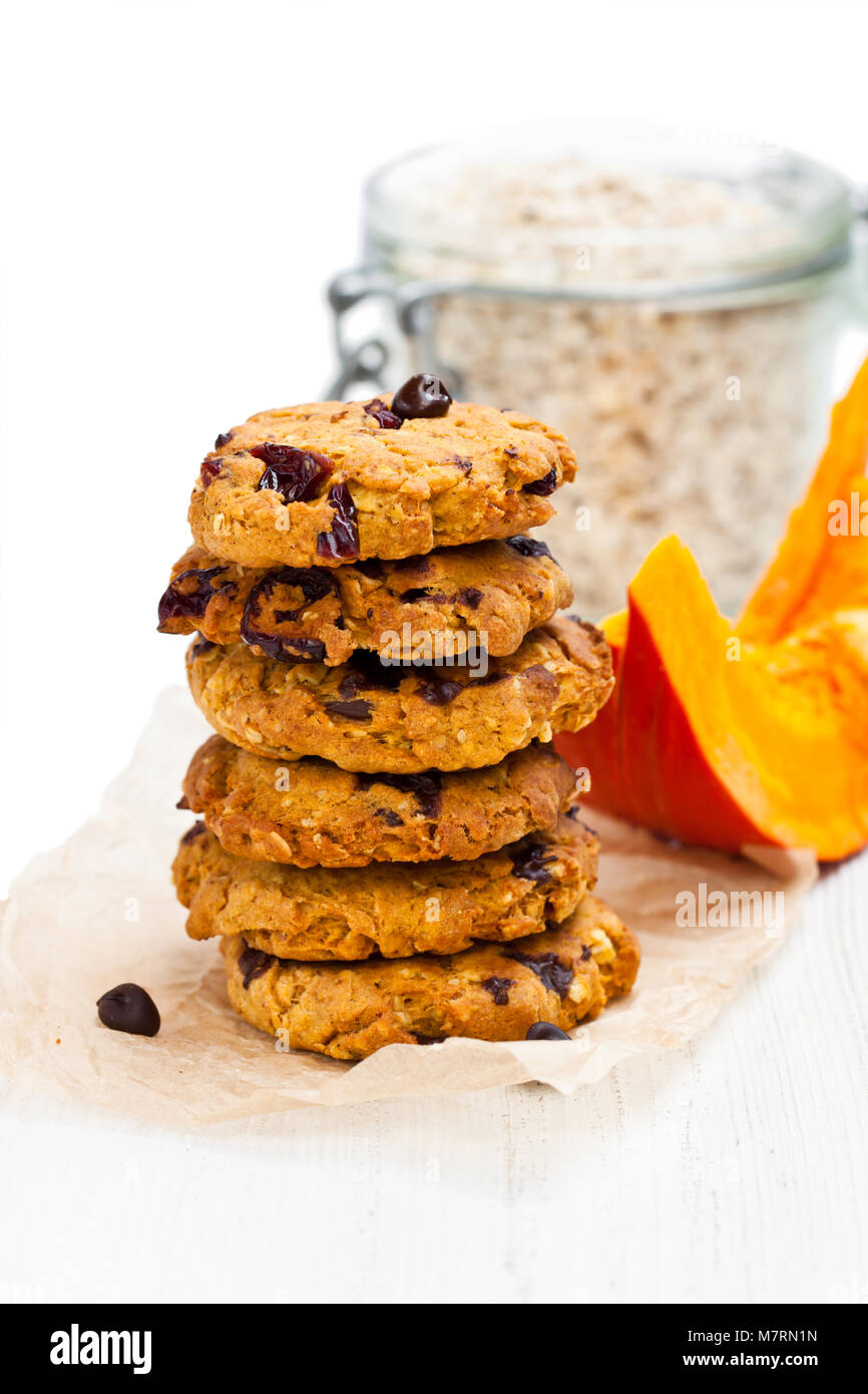 Homemade  pumpkin and orange cookies on white background Stock Photo