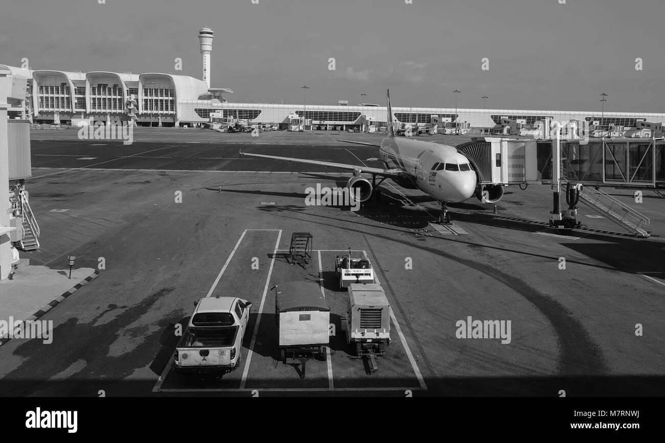 Kuala Lumpur, Malaysia - Oct 17, 2017. Civil aircrafts docking at Kuala Lumpur International Airport (KLIA2). - Stock Image