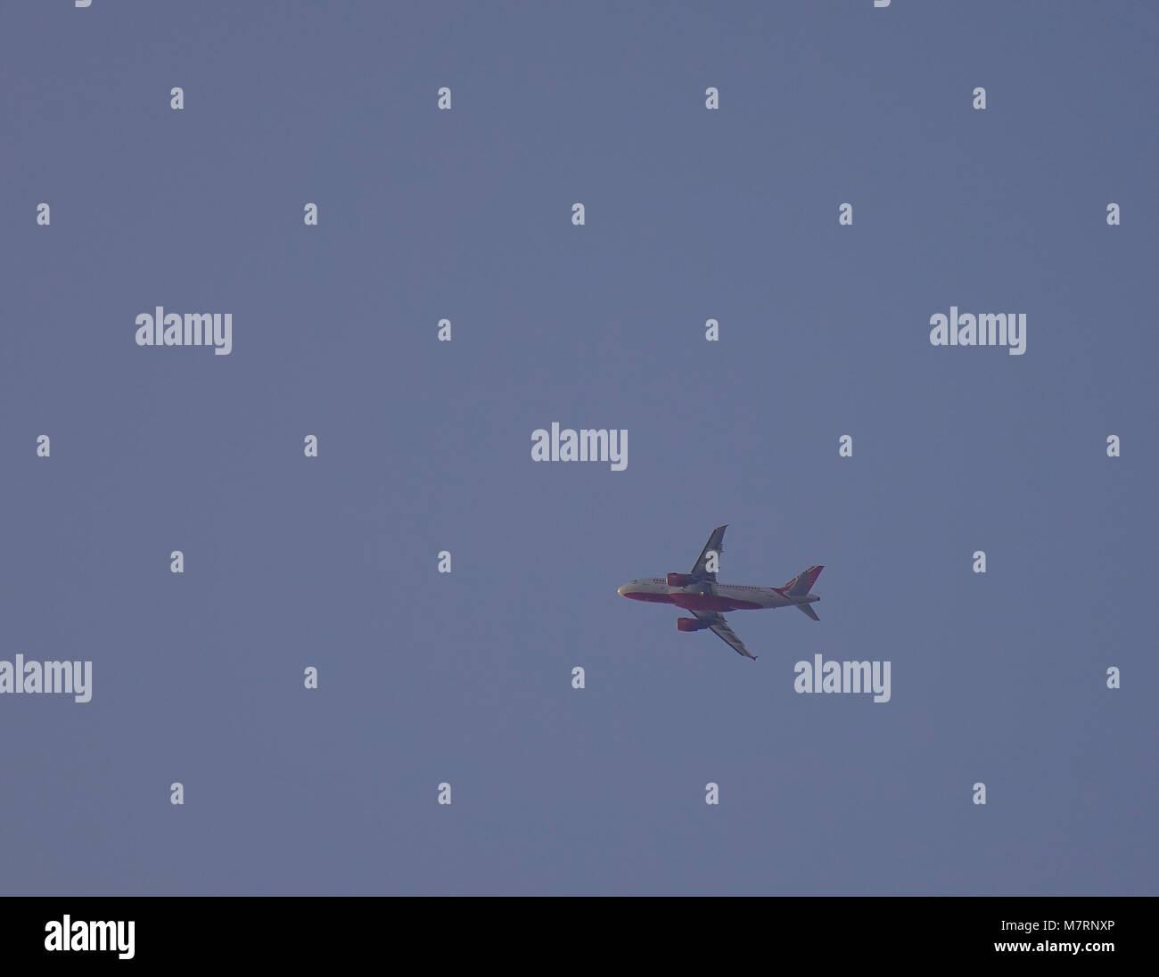 Kathmandu, Nepal - Oct 17, 2017. A civil aircraft flying in the sky in Kathmandu, Nepal. - Stock Image