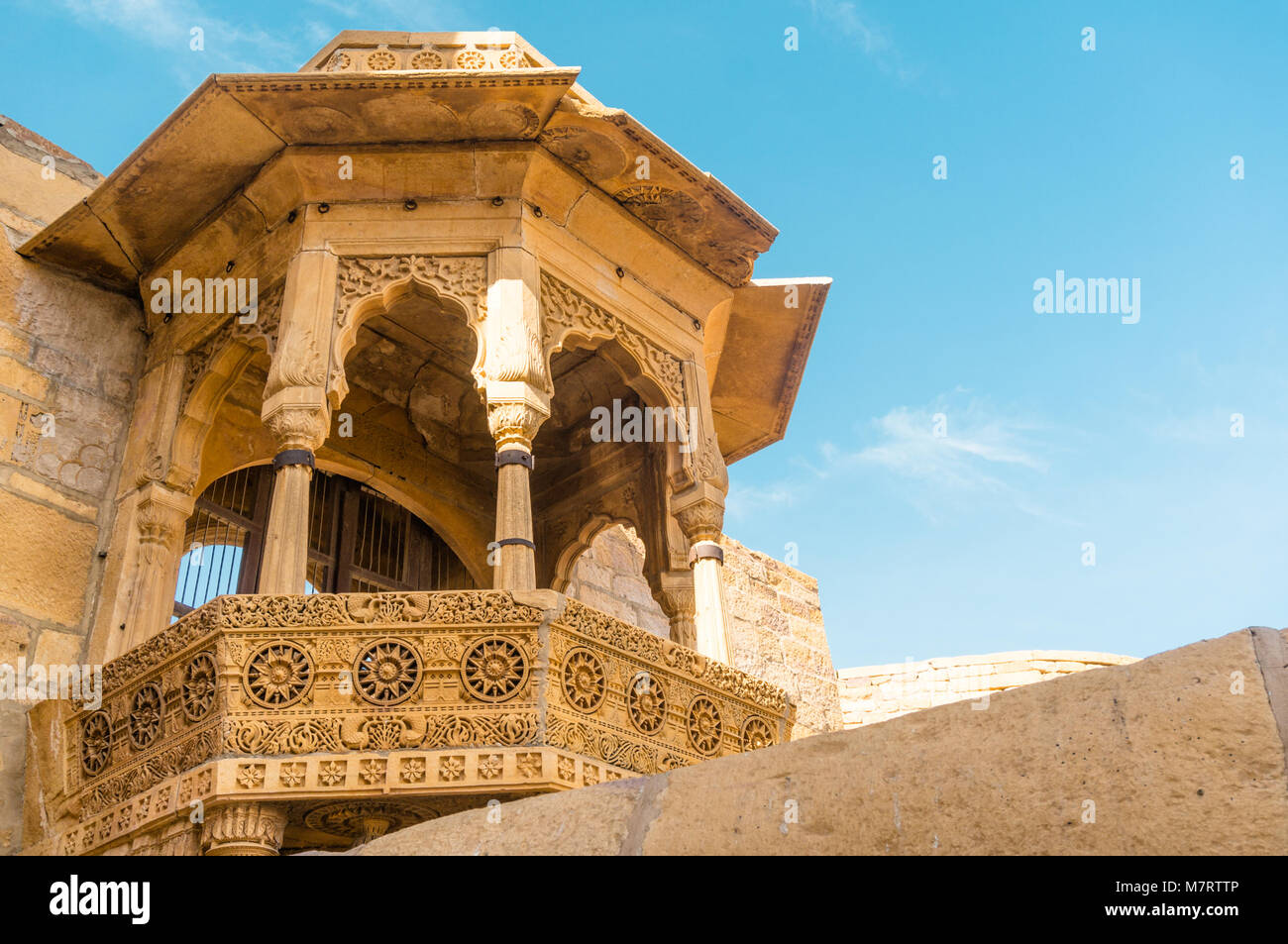Close up of the arches of a rajasthani palace shot against a clear blue sky. This is Jaisalmer's famous sonar - Stock Image
