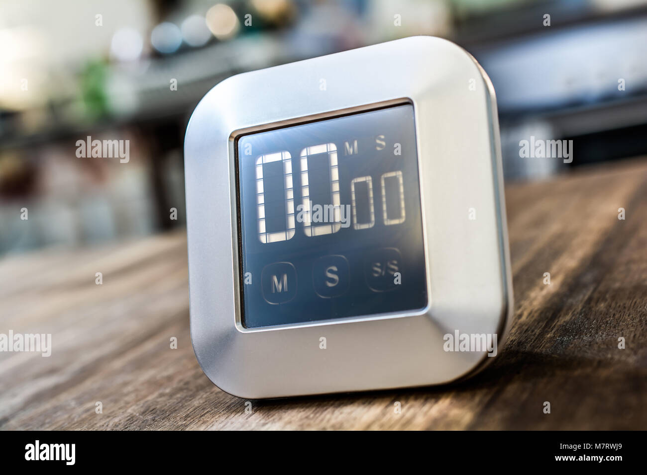 0 Minutes - Closeup Of A Digital Chrome Kitchen Timer On Wooden Table - Stock Image