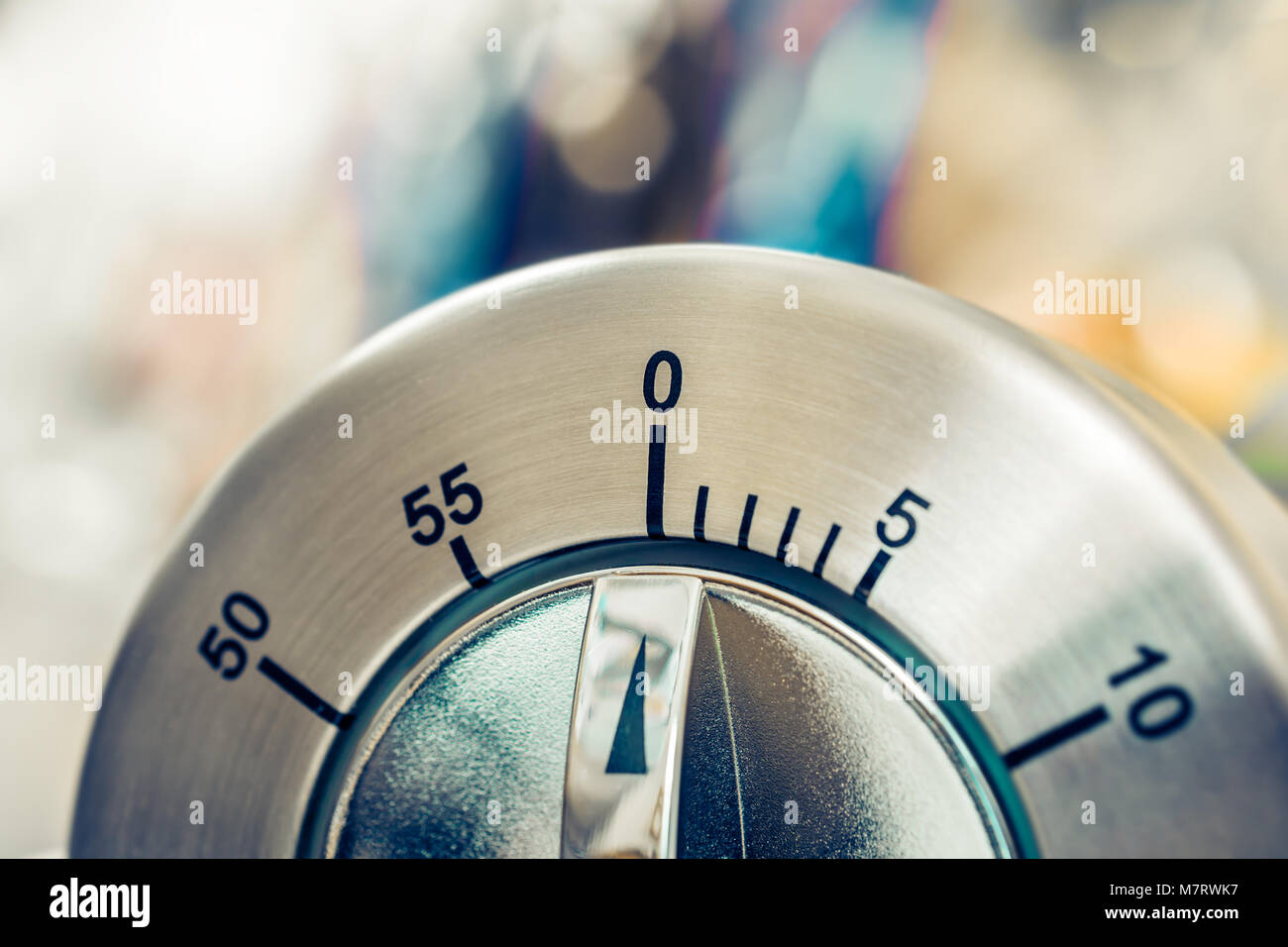 0 Minutes / 1 Hour - Macro Of An Analog Chrome Kitchen Timer - Stock Image