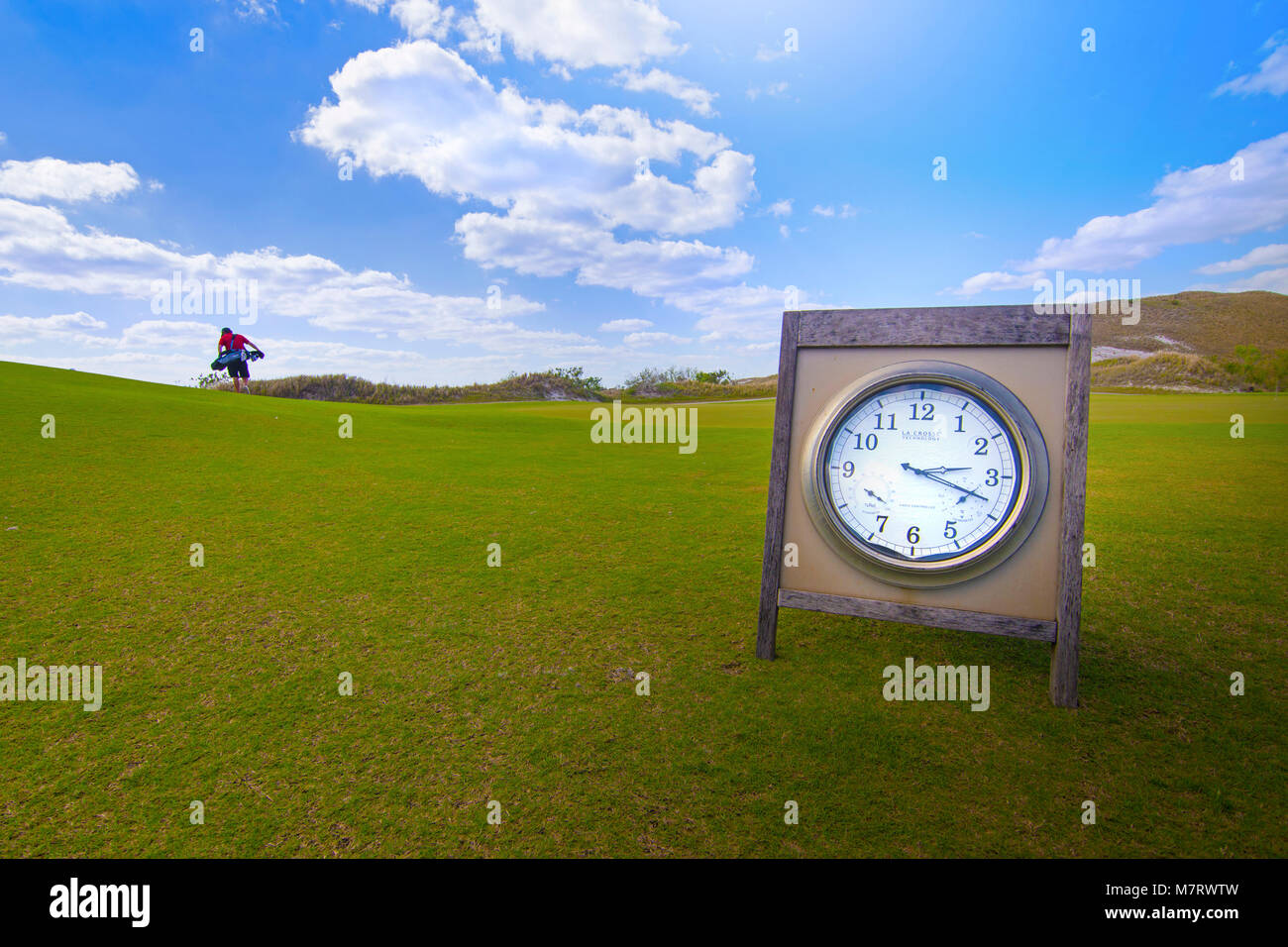 Tee Time - A clock on a golf course in Florida. - Stock Image