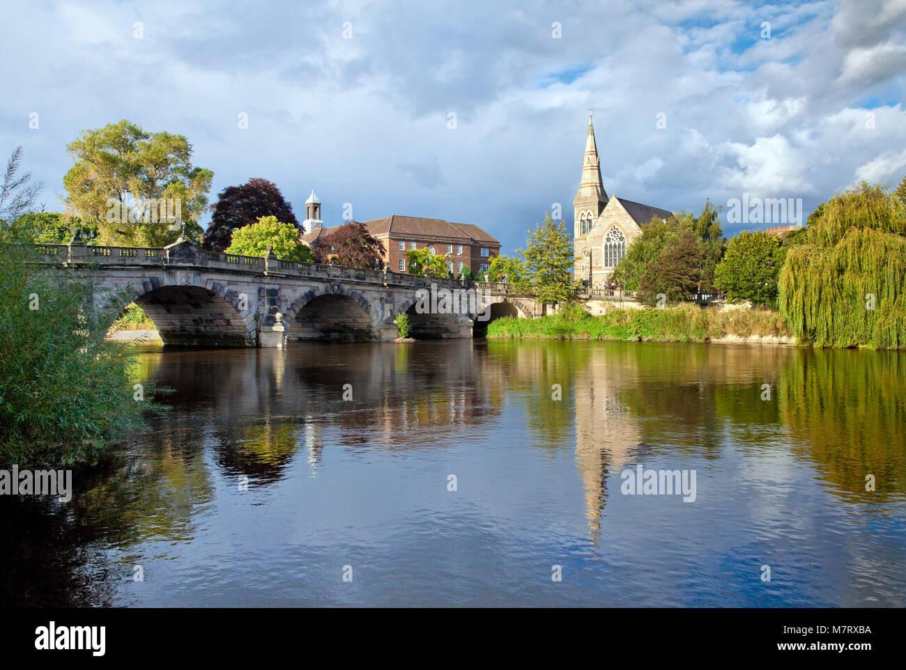 River Severn by English Bridge and United Reform Church Shrewsbury Shropshire - Stock Image