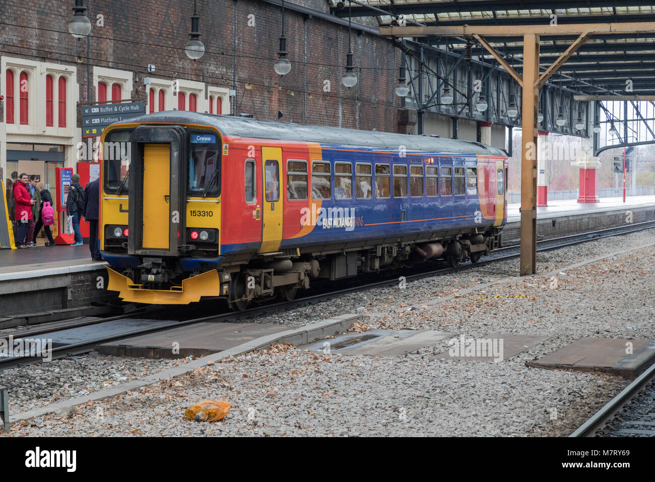 An East Midlands Trains Class 153 diesel train at Stoke On Trent station running  a service to Crewe - Stock Image
