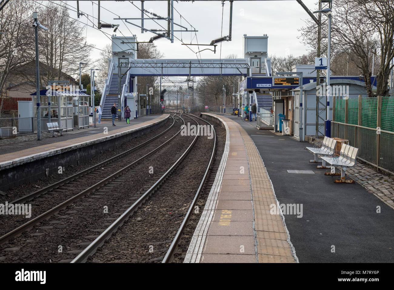 Westerton train station in Glasgow. This a westbound view, the next station on the line is Drumchapel - Stock Image