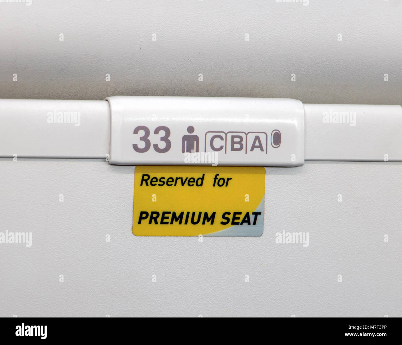 A sign of priority seats on the aircraft. Indication of premium seat at airplane. Stock Photo