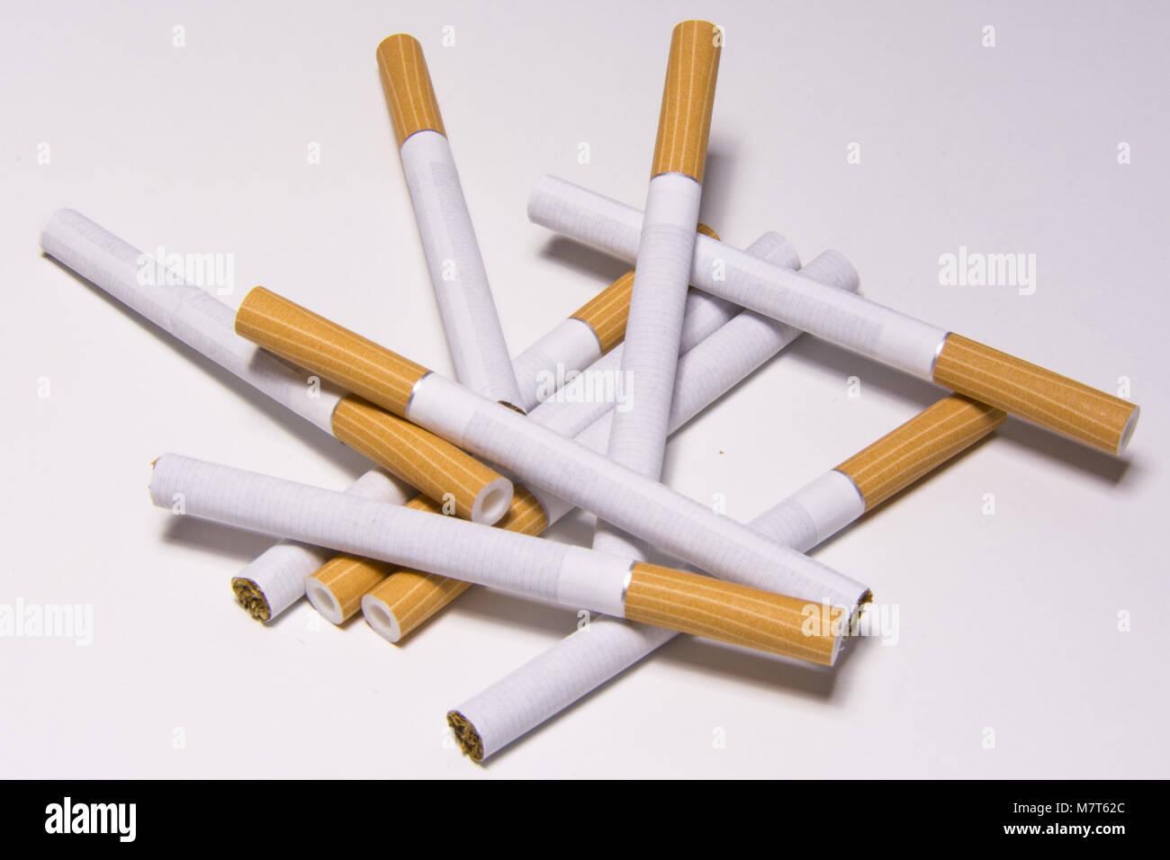 Cigarette on white background, unhealthy lifestyle, toxic nicotine - Stock Image