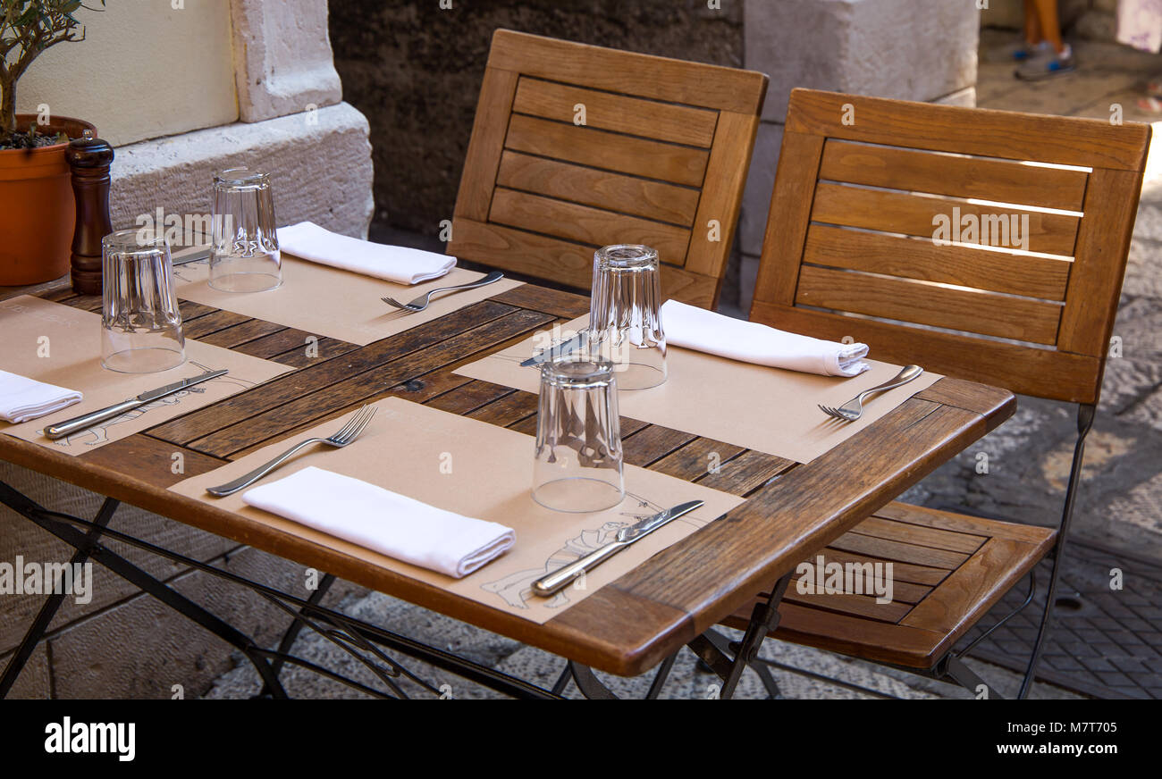 Excellent Glasses Forks Knives Napkins On A Brown Wooden Table Download Free Architecture Designs Aeocymadebymaigaardcom