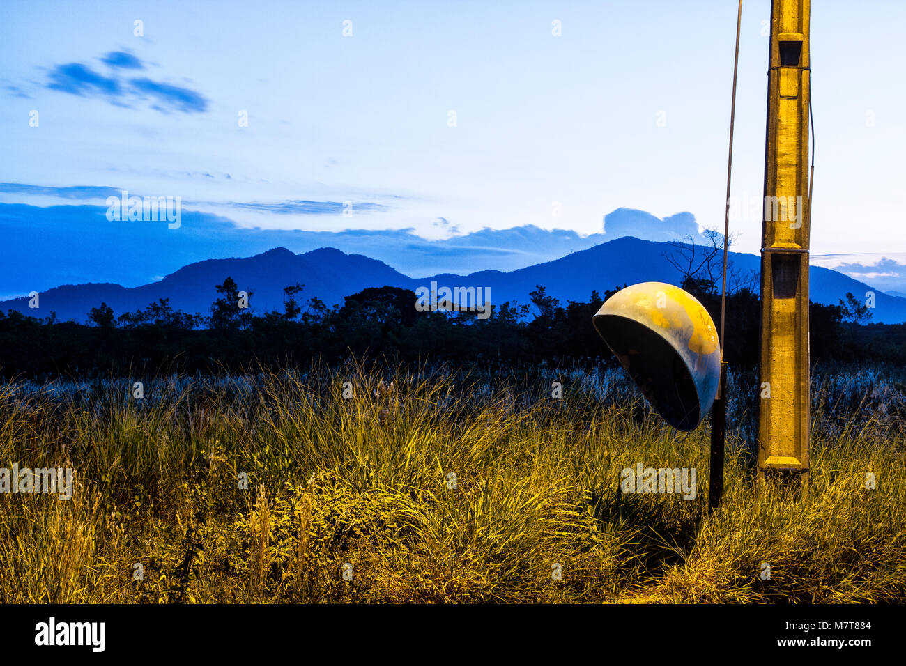 Public phone booth in a vacant lot at evening. Florianopolis, Santa Catarina, Brazil. Stock Photo