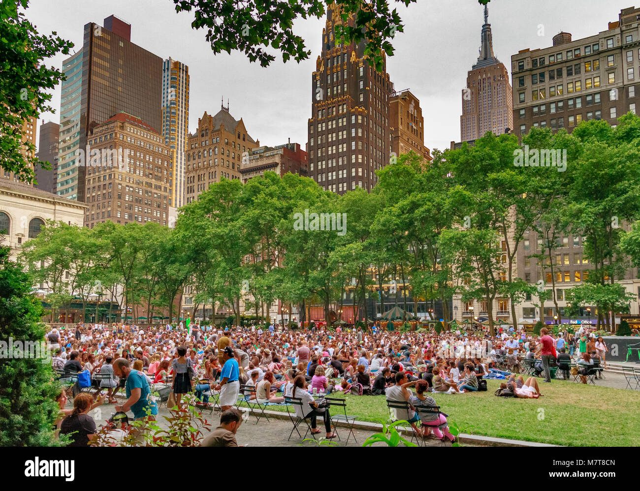 Crowds gathered in Bryant Park , Manhattan for Bryant Park Film Festival , New York ,NY - Stock Image
