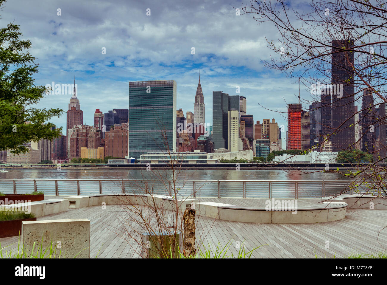 Midtown Manhattan and The United Nations Building from Gantry Plaza State Park in Long Island City ,Queens , New - Stock Image