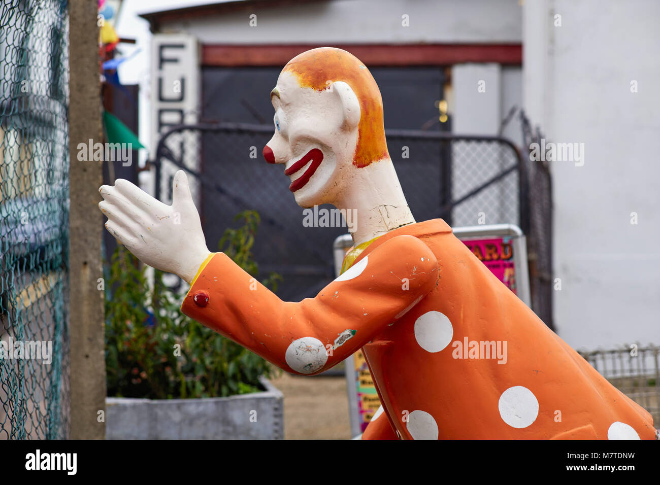 A clown figure from Dreamland for sale in a store in Margate - Stock Image