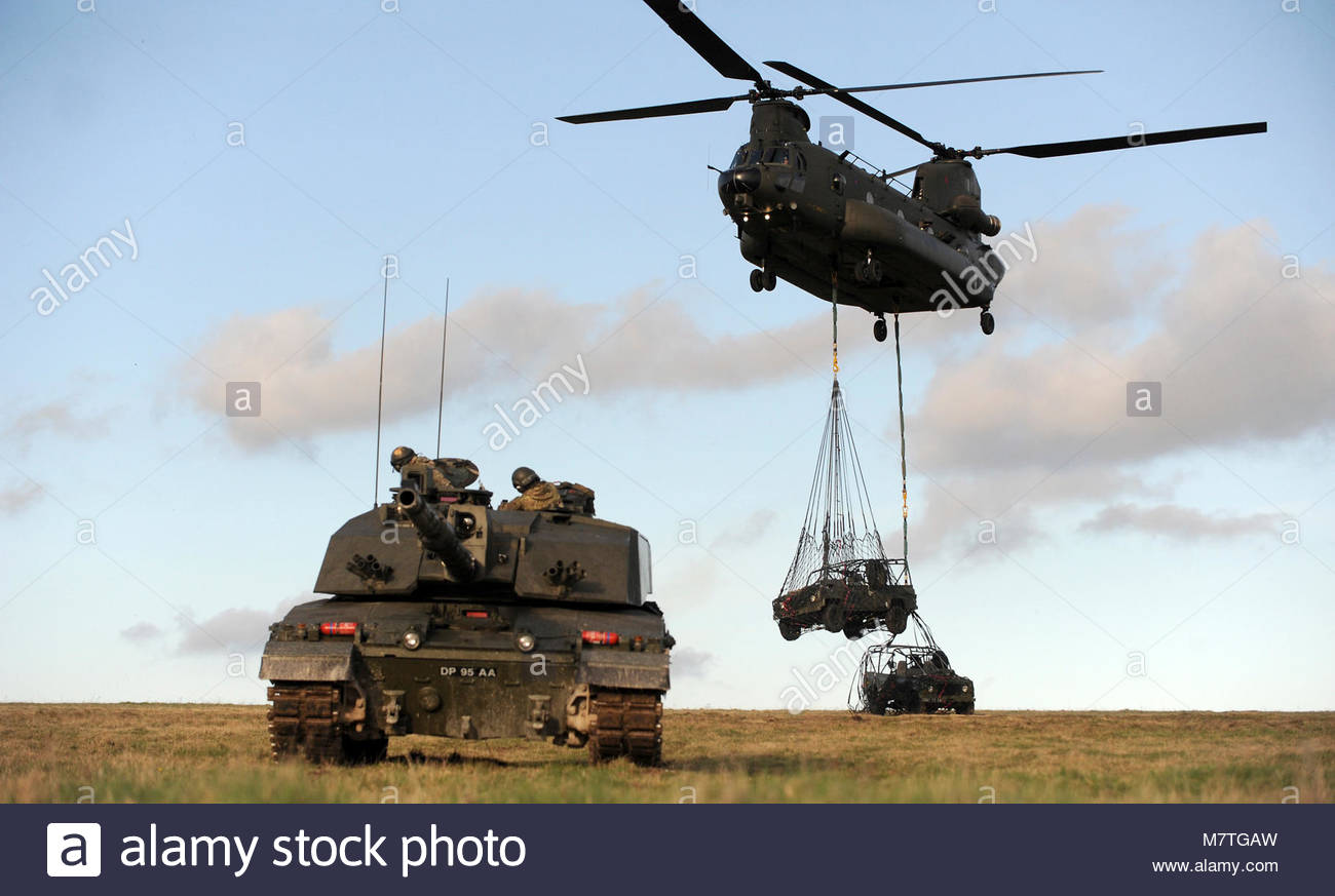 ArmyHQ-2014-023 RWxY Ex Spring Warrior-059. Pictured is a Challenger 2 MBT and Chinook Helicopter on the Salisbury Stock Photo