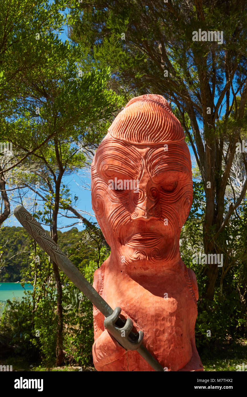Maori carving at Anchorage, Abel Tasman National Park, Nelson Region, South Island, New Zealand - Stock Image
