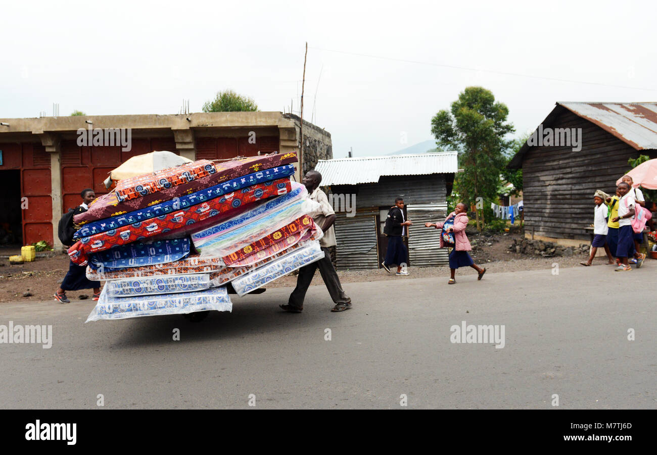 Transporting mattresses  in the city of Goma. - Stock Image