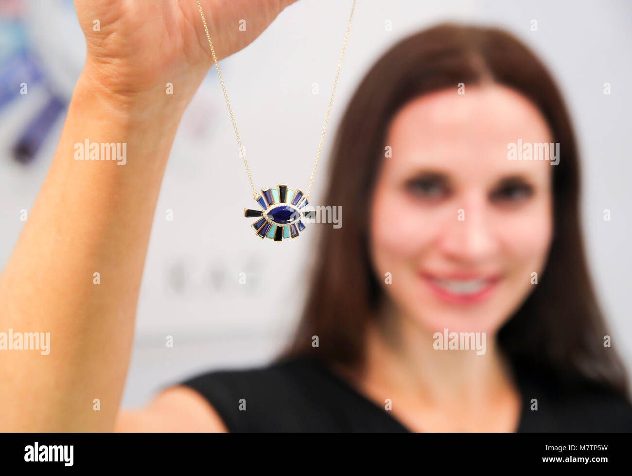 (180312) -- NEW YORK, March 12, 2018 (Xinhua) -- Jewelry Designer Theresa Kaz shows her design at her booth at the - Stock Image