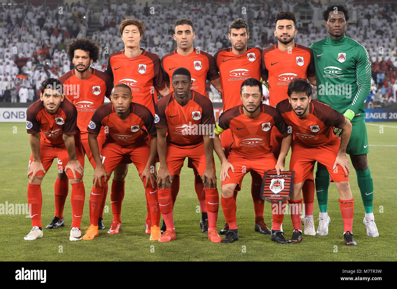 (180313) -- DOHA, March 13, 2018 (Xinhua) -- Al-Rayyan's players line up prior to the AFC Champions League Group Stock Photo