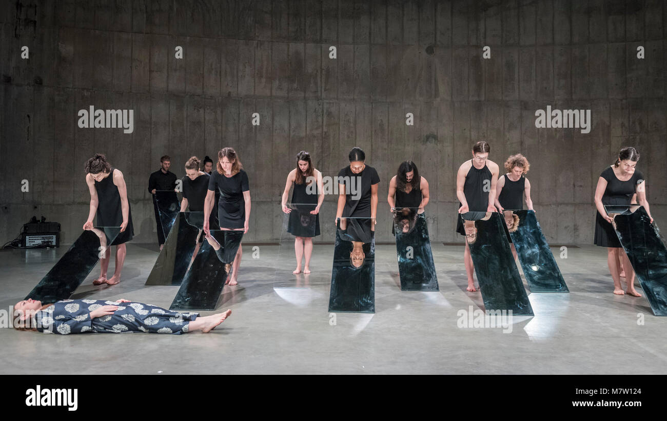 "London, UK.  13 March 2018. Performers present ""Mirror Piece II"", 1969/2018.  Preview of ""Joan Jonas"" at Tate Modern. Stock Photo"