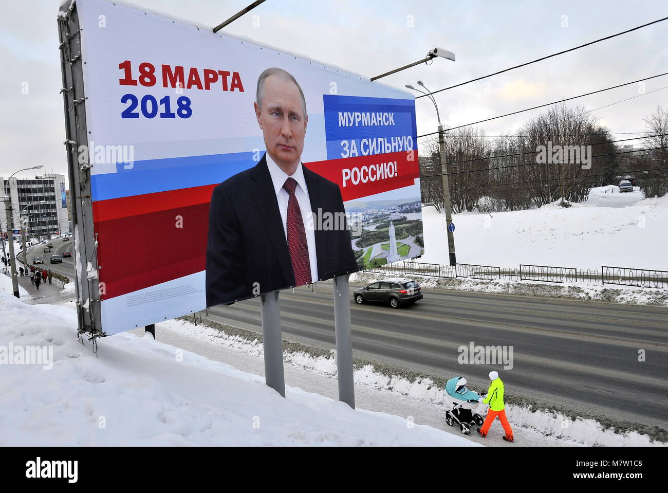 MURMANSK, RUSSIA - MARCH 12, 2018: A billboard poster promoting Russian President Vladimir Putin in a street. Putin - Stock Image