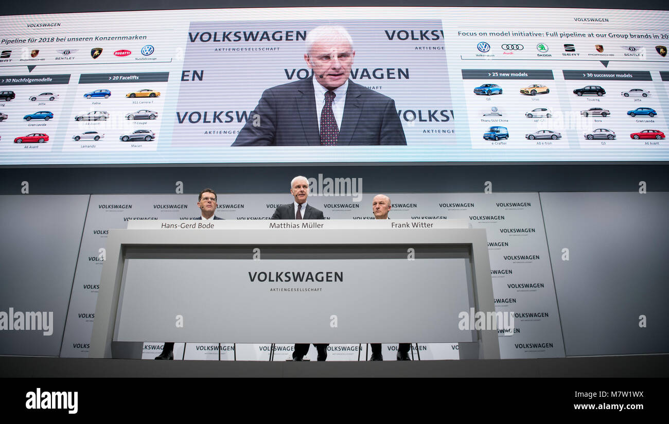 13 March 2018, Berlin: Matthias Mueller (C), chairman of the board of Volkswagen AG, CFOFrank Witter (R)and - Stock Image