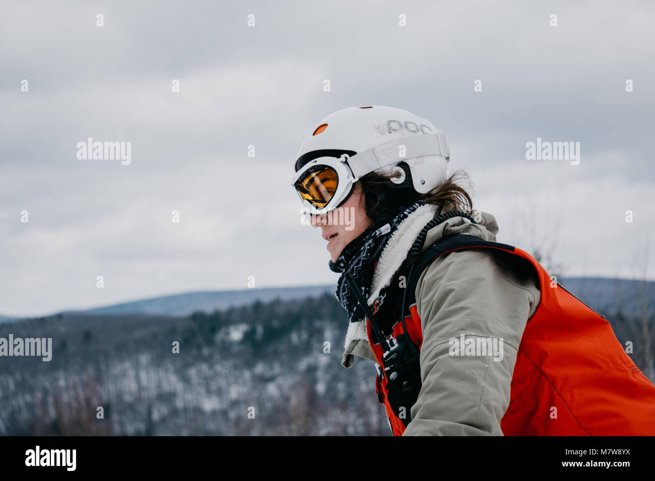 female ski patroller on mountain - Stock Image