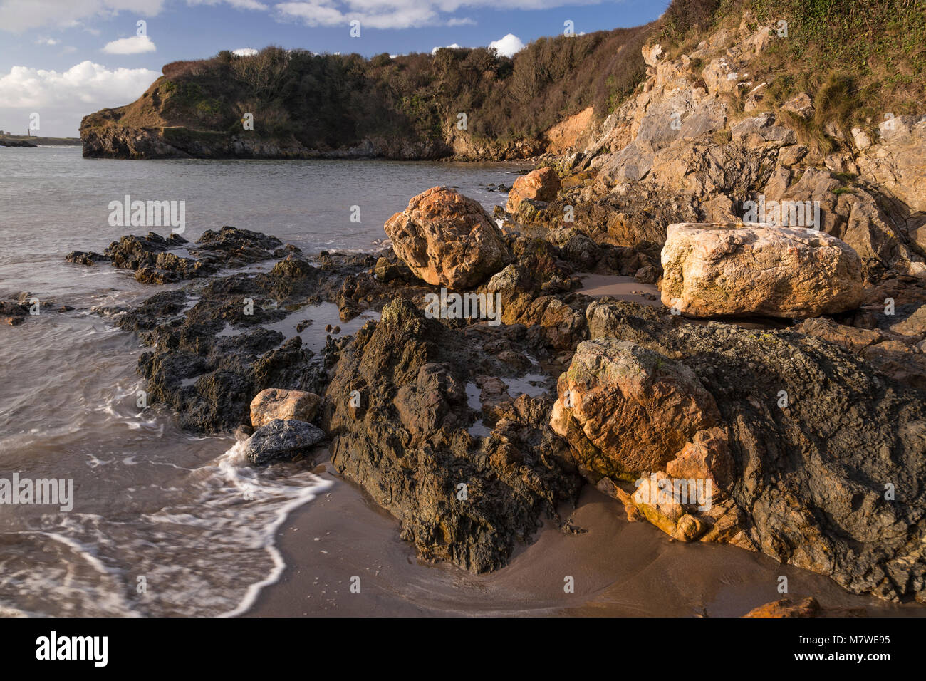 Rocks on the  beach at Cemaes Bay, Anglesey, North Wales coast Stock Photo