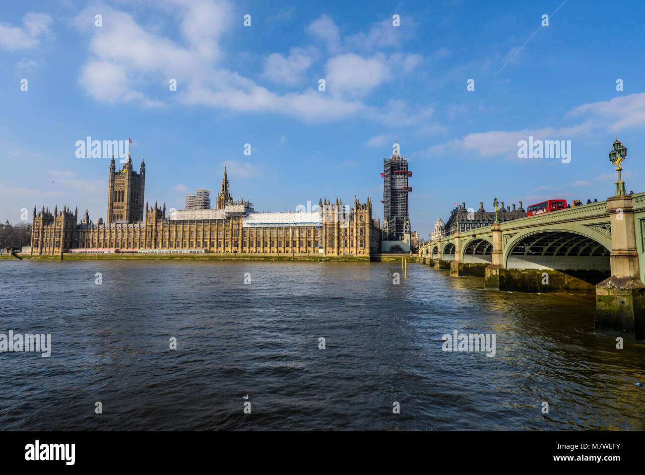 Palace of Westminster Houses of Parliament Westminster Bridge and River Thames, London, UK. Blue sky. Big Ben Elizabeth Stock Photo