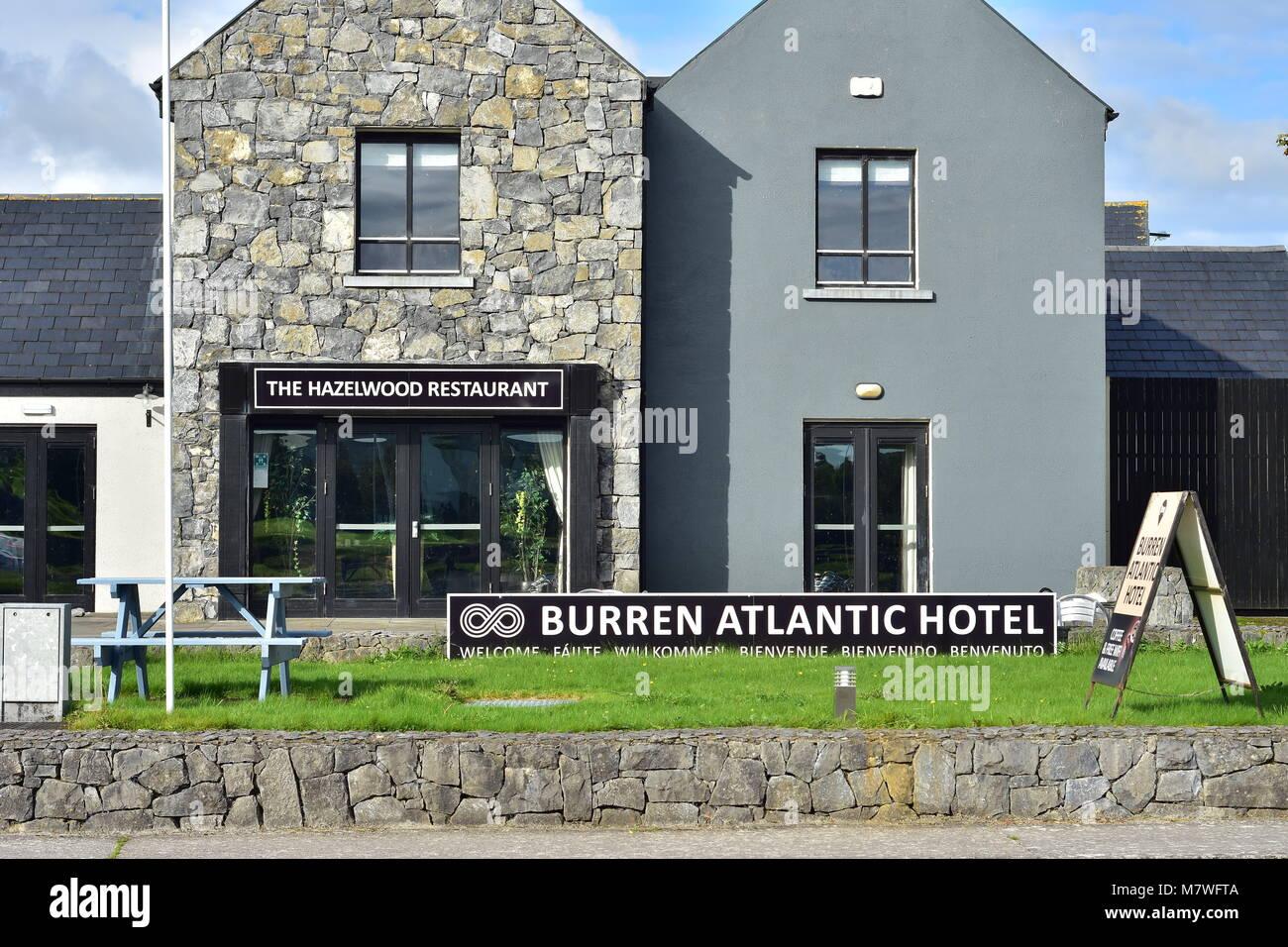 Small Burren Atlantic Hotel with restaurant in village of Ballyvaughan on Atlantic coast of in western Ireland. - Stock Image