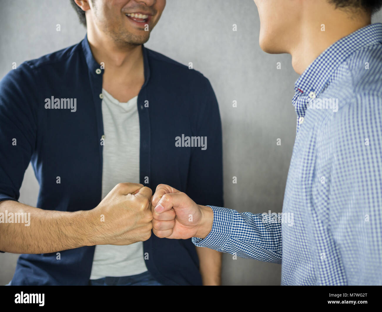 Friendship fist bump greeting togetherness stock photos friendship fist bump making by two men smiling stock image m4hsunfo