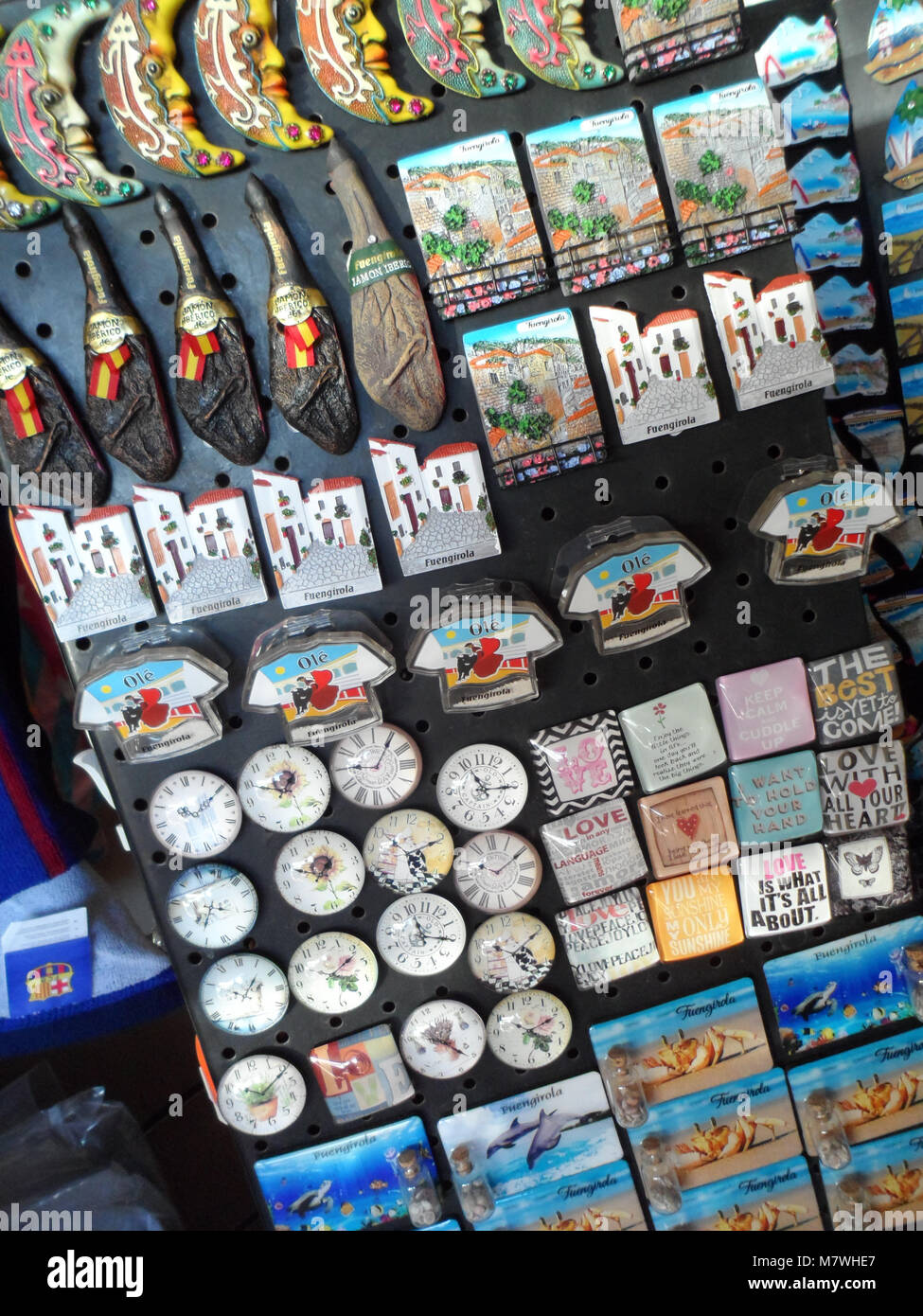 A collection of fridge magnets in a tourist shop taken in Fuengirola, Spain - Stock Image