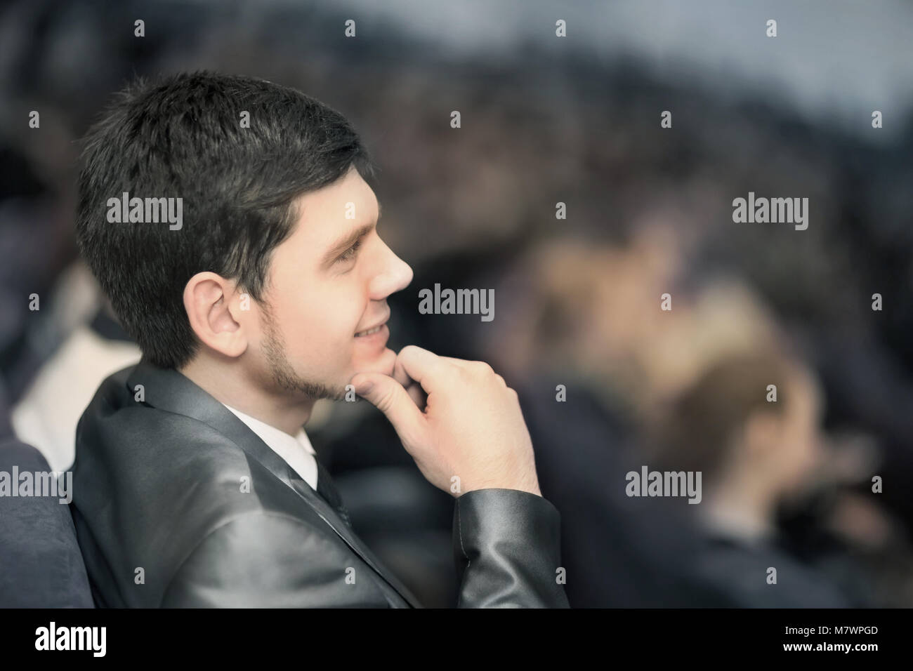 successful businessman sitting rear at the business conference. - Stock Image
