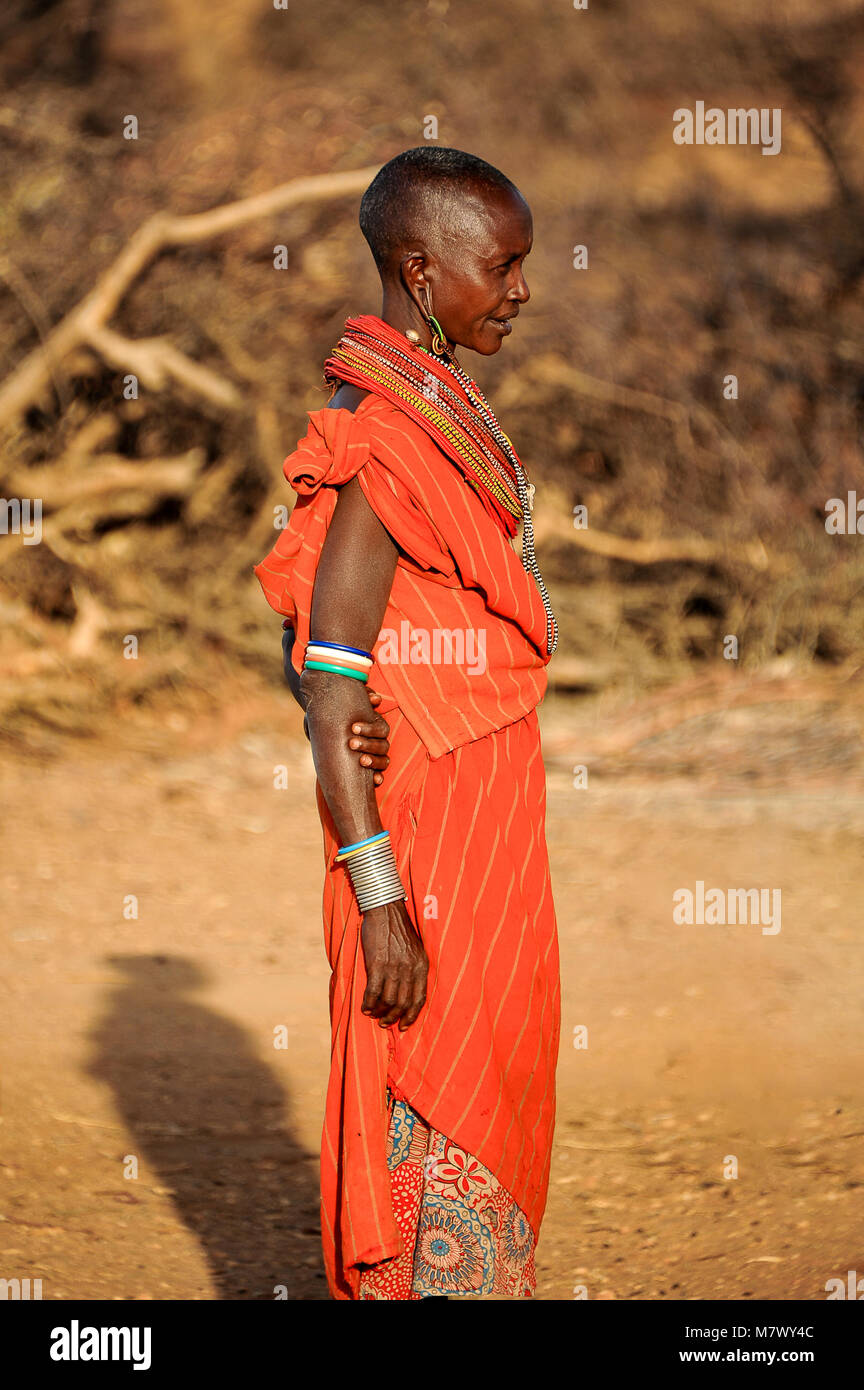 Portrait of an African woman from the Samburu tribe in striking, orange-coloured, traditional dress Stock Photo