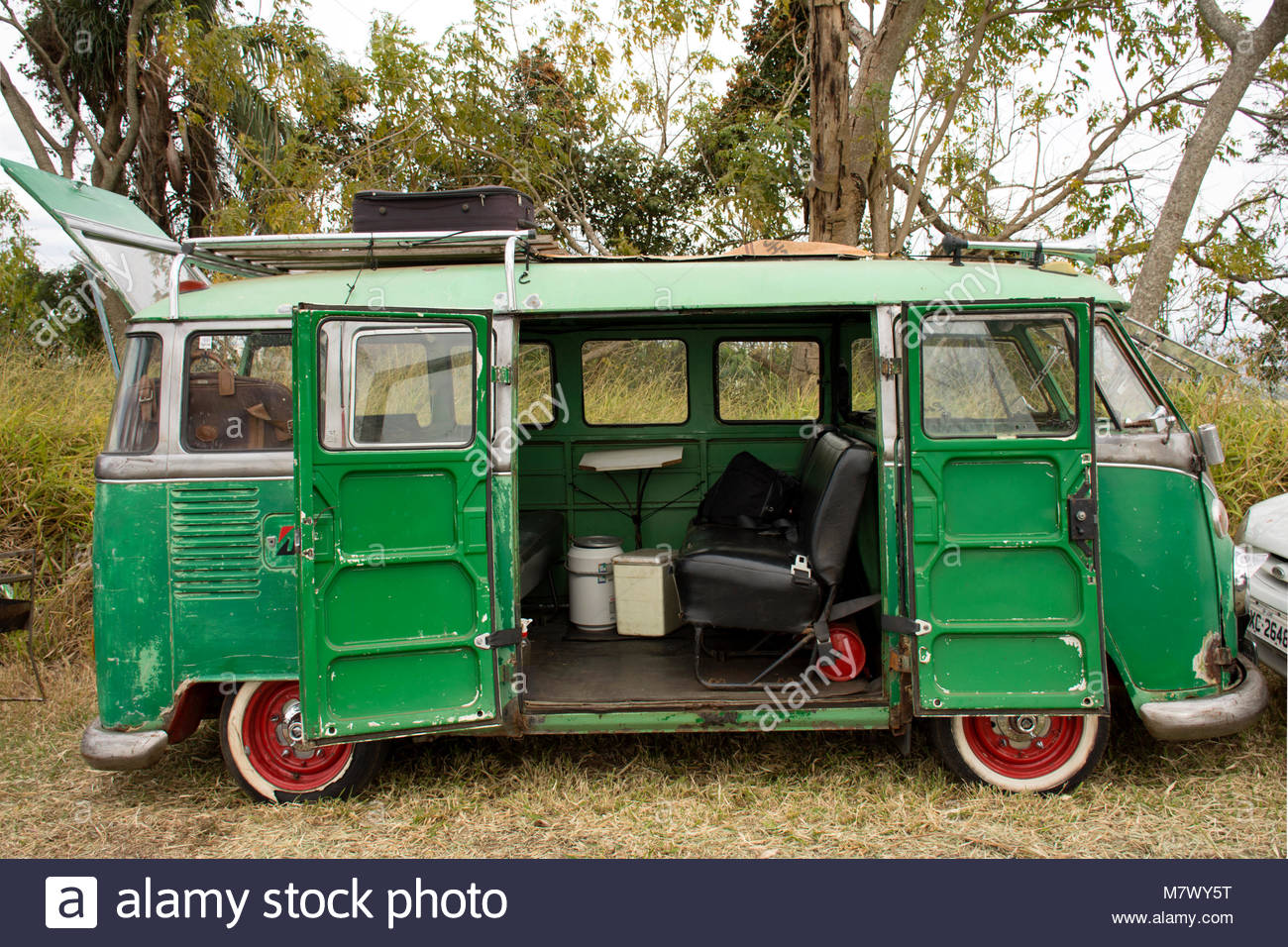 7798b08c2c3cf9 Very old green Volkswagen Kombi  Camper from a traveller - Stock Image
