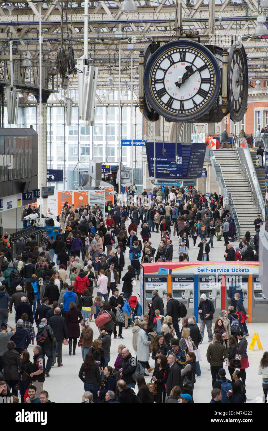 crowds of commuters at Waterloo station UK - Stock Image