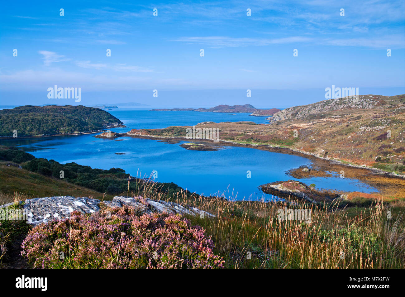 A view over a tidal inlet to Eddrachillis Bay and the open sea beyond, seen from the A894 near Scourie, Sutherland, - Stock Image