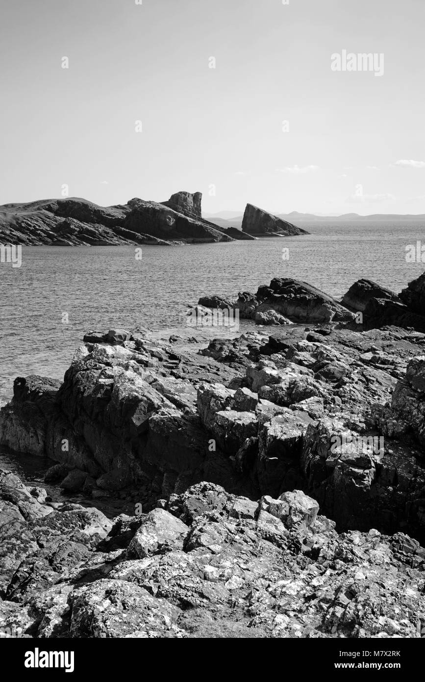 The Split Rock at Clachtoll Bay seen across the rocky foreshore, Assynt, Sutherland, North Coast 500 route, Scottish - Stock Image