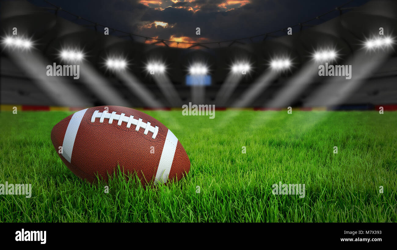 American football arena with ball on green grass illumination at night, 3D rendering - Stock Image